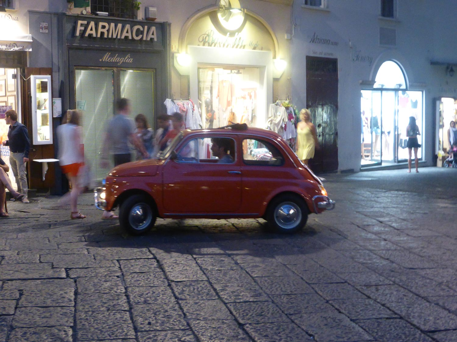 Common Fiat vehicle driving through Piazza Italy