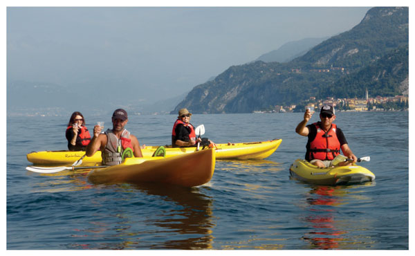 Group enjoying a glass of Prosecco on Lake Como kayaking adventure
